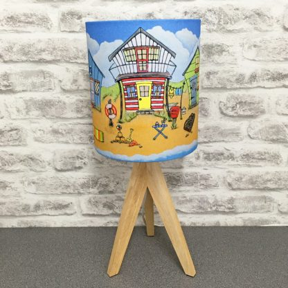 red and white Bech hut showing on five little beach huts by the sea lampshade