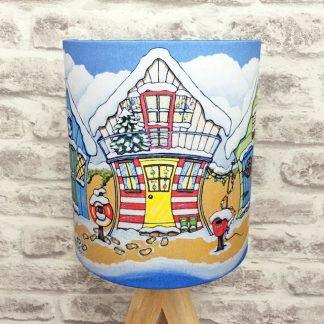 five colourful beach huts in the snow lampshade